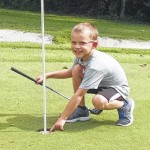 Five-year-old makes hole in one