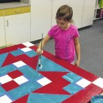 Shoals Elementary Students prepare for the annual PTO fundraiser by making barn quilts to be auctioned off