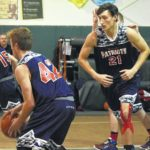 Surry boys end skid, girls win conference