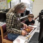 Rotarians read to Flat Rock students